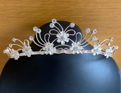 Silver and diamante tiara with ivory flower